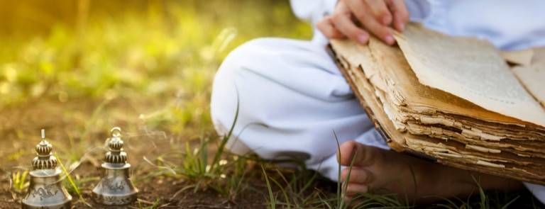 man meditating with old book