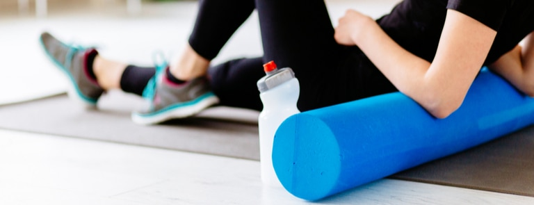 woman stretching on foam roller