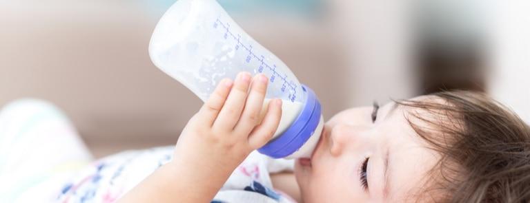 baby drinking milk bottle