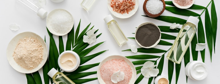 vegan beauty products on a natural background of leaves