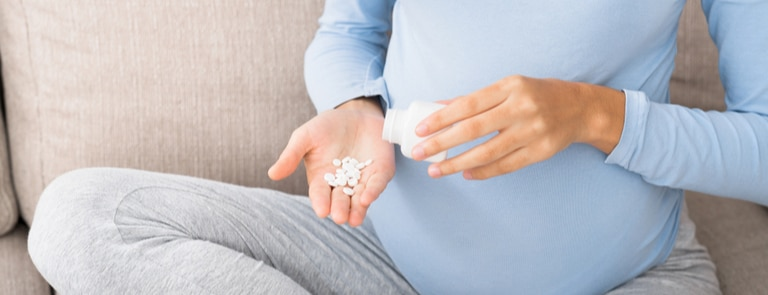 pregnant woman taking vitamins