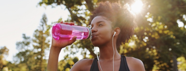 young woman drinking pre workout