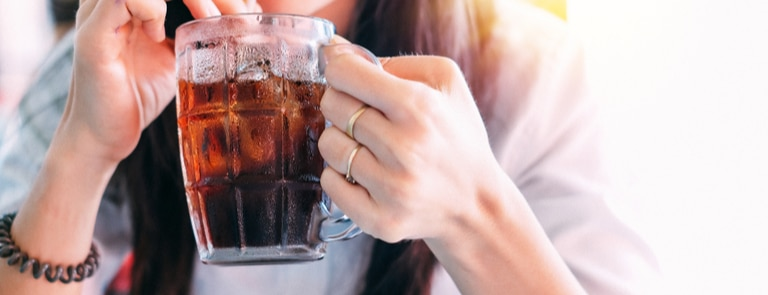 Woman sipping a fizzy drink