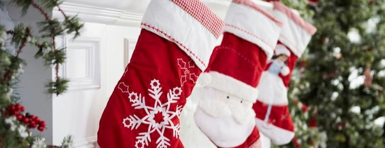 christmas stockings hung up on fireplace