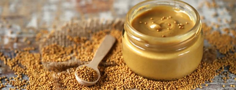 mustard seeds and a jar of mustard