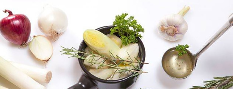 What is vegan 'bone' broth and how can I prepare it?