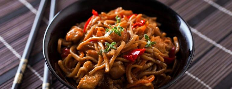 Chicken Noodles Next To Chopsticks