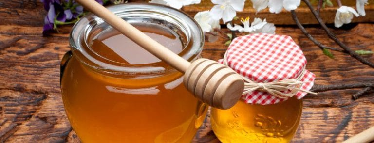 Two Jars of Honey with a honey dipper
