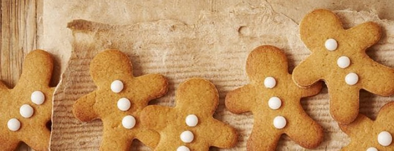 Gingerbread men biscuits on parchment paper