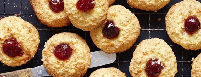 Coconut and millet biscuits with a cherry on top