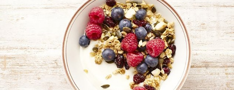 A bowl of cranberry and macadamia granola