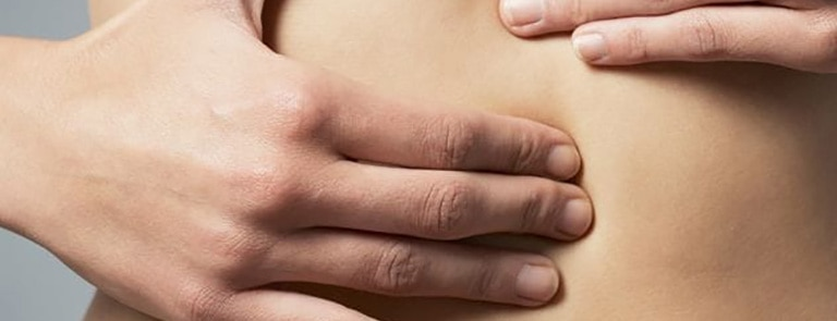 A women pressing into her stomach