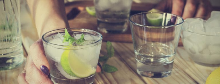 Glasses of Gin and Tonic with lime and ice