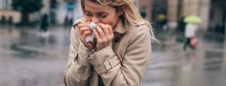 Winter woman sneezing