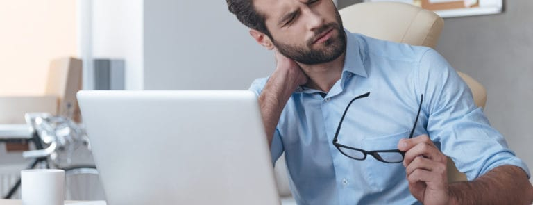 Man on laptop with neck pain
