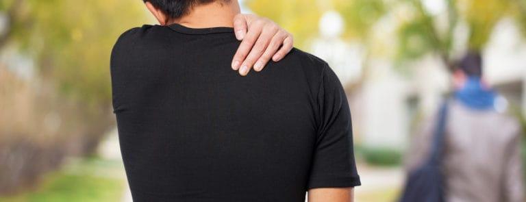 man suffering a back ache
