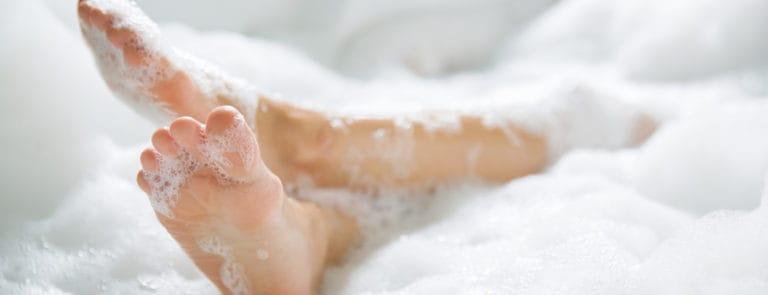 Woman's feet in bubble bath