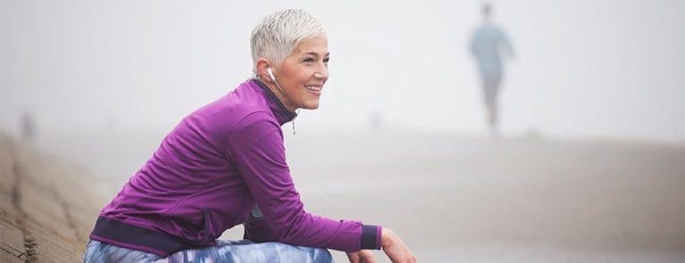Older woman resting mid-jog