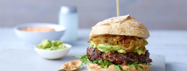 Vegan burger in bun made from black beans, rice and tofu