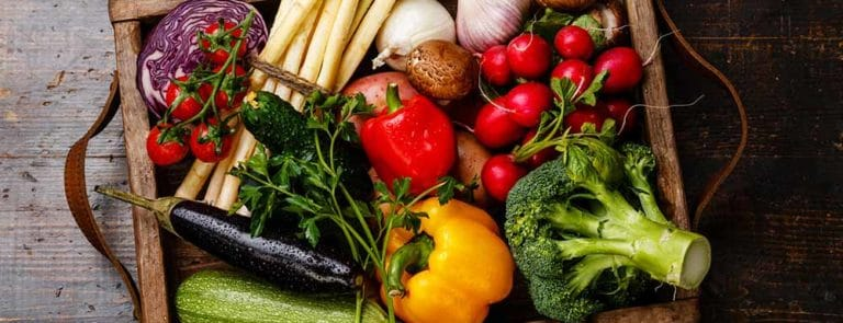 Wooden crate of vegetables