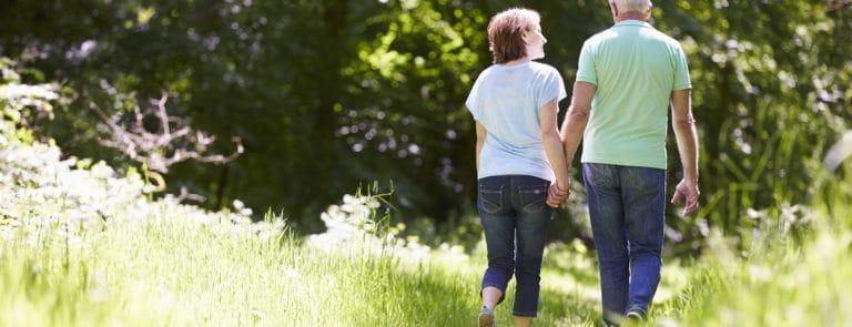 Healthy, happy older couple on a walk