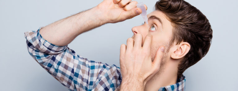 man applying eye drops as a eye strain remedy
