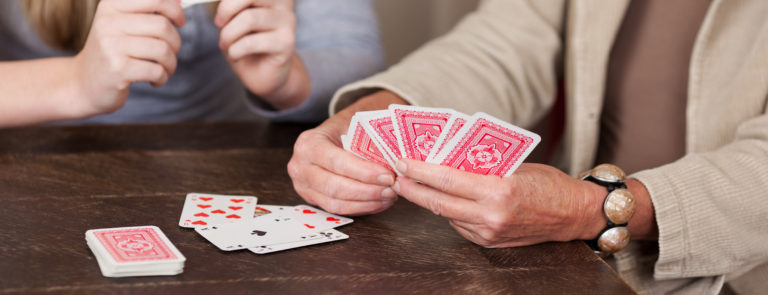 playing cards is a great activity for the elderly to keep their mind active