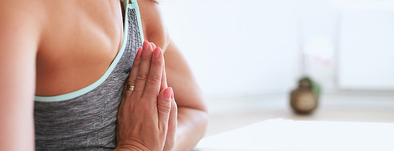 woman doing reverse prayer to stretch shoulders