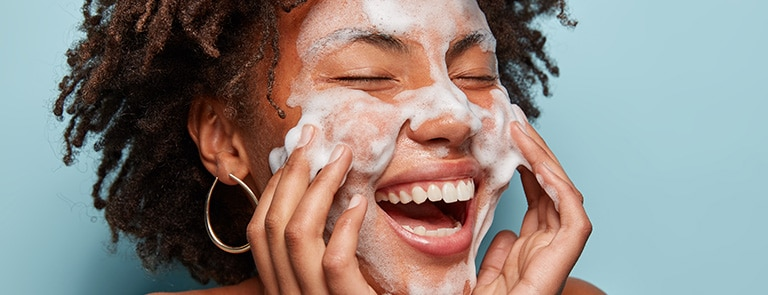 woman double cleansing her face