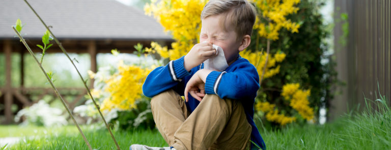 a young boy experiencing hay fever