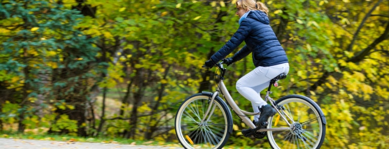 woman exercising outside cycling