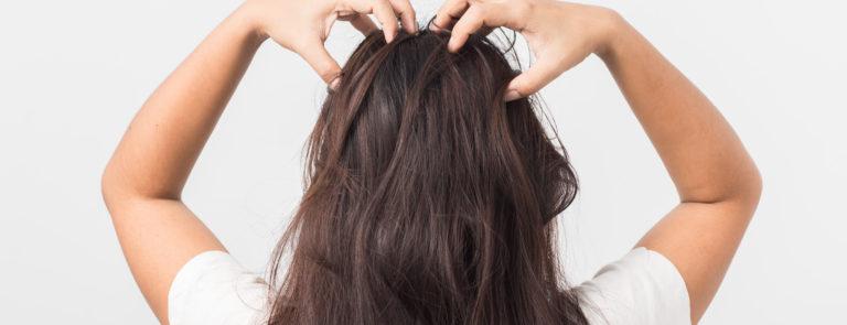 a woman massaging her scalp