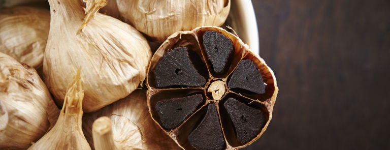 Black garlic: benefits and supplements image