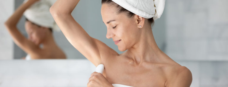 woman applying natural deodorant