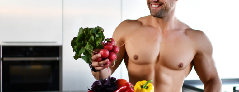 muscular man with vegetarian foods