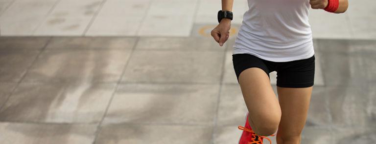 someone running outside wearing sports wear