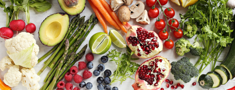 A variety of keto friendly fruits and vegetables including, avocado, asparagus, mushrooms, tomatoes and more,