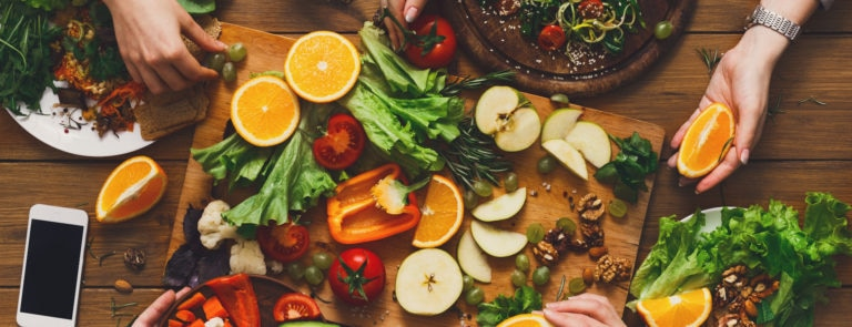 A chopping board with a variety of vegetarian foods high in protein.