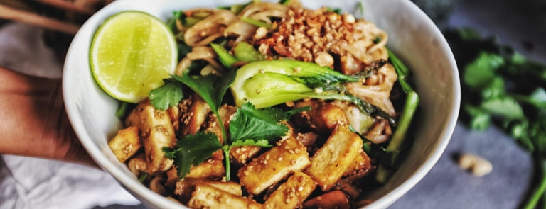 A Buddah bowl including tofu, rice and green vegetables.